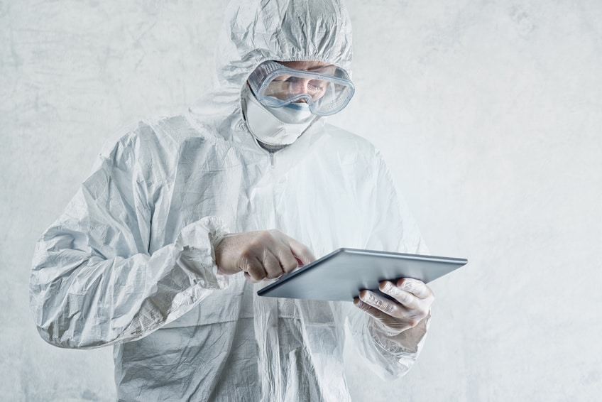 Chemical Scientist in Protective Laboratory Clothing Using Digital Tablet Computer