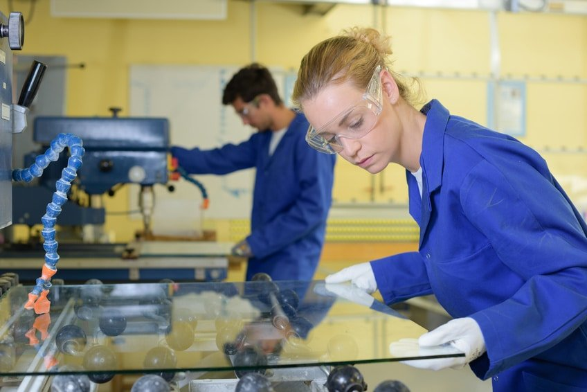 Young people working with glass