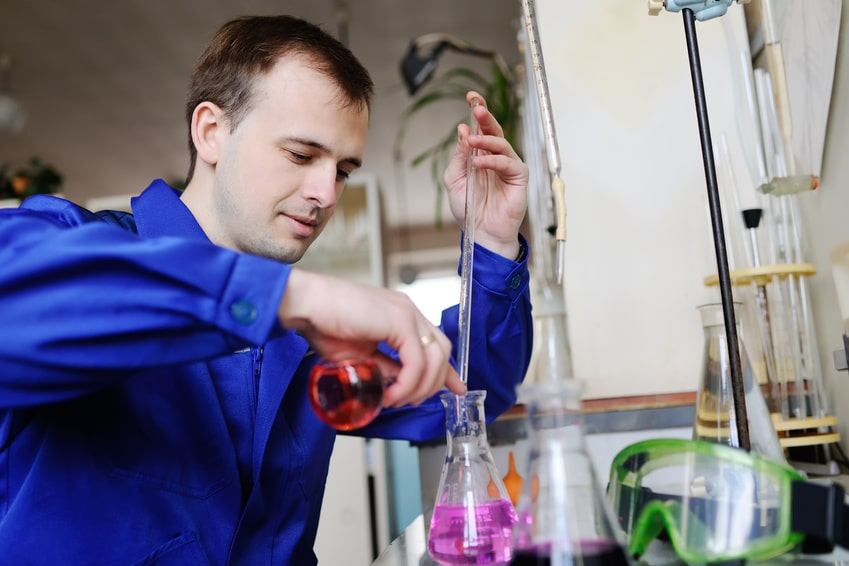scientist-with-chemicals-laboratory