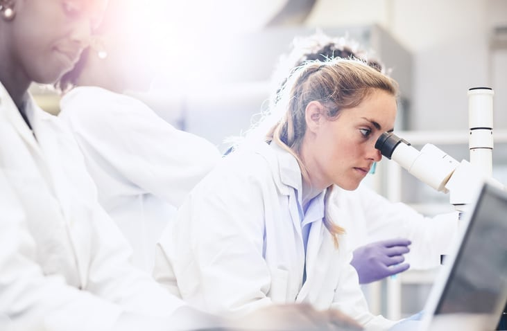 scientist using microscope laboratory